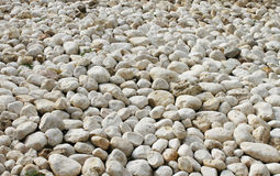 Lots of white stones. White stone background Royalty Free Stock Photos