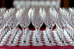 Lots of wine glasses. On red tablecloth Stock Photography