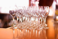 Lots of wine glasses during some festive event Stock Photos