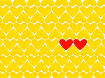 Lots of yellow hearts and two red Royalty Free Stock Photography