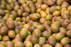 Lots of yellow olives Stock Photo
