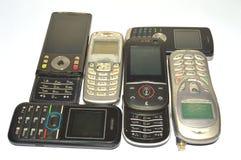 Lott av gamla mobiltelefoner Fotografering för Bildbyråer