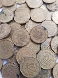 lott av mynt av 20 cent av mexikanska pesos, besparingar och samlingen Arkivbilder