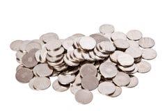 lott av mynt på vit bakgrund Arkivbild