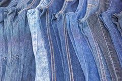 Lott av olik jeans, selektiv fokus royaltyfria bilder