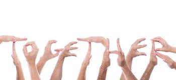 Lotten av händer bildar ordet tillsammans royaltyfria foton
