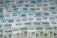 Lotter av polska valutasedlar som en bakgrund Arkivfoton