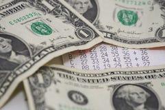 Lottery. Ticket under dollar bills stock photos
