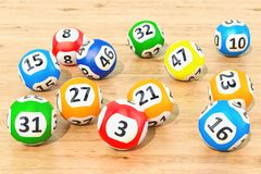 Lottery balls closeup on the wooden table, 3D rendering. Lottery balls closeup on the wooden table, 3D Stock Photography