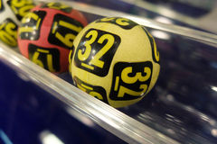 Lottery balls during extraction. Image of lottery balls during extraction of the winning numbers Royalty Free Stock Image