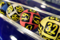 Lottery balls during extraction. Image of lottery balls during extraction of the winning numbers Stock Photo