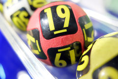 Lottery balls during extraction. Image of lottery balls during extraction of the winning numbers Royalty Free Stock Photo