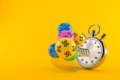 Lottery balls with stopwatch. Isolated on orange background. 3d illustration Royalty Free Stock Image