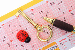 Lottery. Filled lottery ticket with golden key and ladybug stock photos