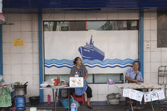 Lottery seller in Bangkok Stock Photo