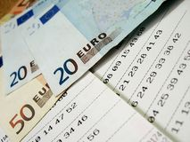 Lottery ticket - 3. Lottery ticket with euro bills, close-up, shallow DOF stock photography