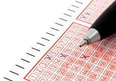 Lottery ticket. Close-up of lottery ticket and ballpoint pen Royalty Free Stock Photography