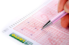 Lottery ticket and pen Stock Images