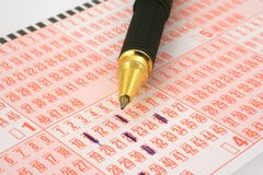 Lottery ticket and pen Royalty Free Stock Image