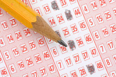 Lottery Ticket and pencil Stock Image