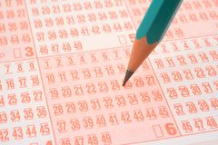 Lottery ticket and pencil Royalty Free Stock Photography