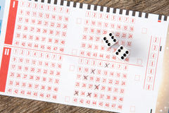 Lottery ticket with two dices Royalty Free Stock Photo