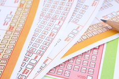Lottery tickets. Lottery ticket with ticked numbers and pencil Stock Images