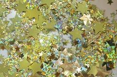 Lotti delle stelle Sparkly dell'oro Fotografia Stock
