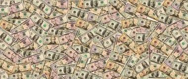 Lotto dei dollari americani dei contanti nei precedenti Fotografie Stock
