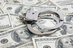 Lotto dei dollari e delle manette fotografie stock libere da diritti