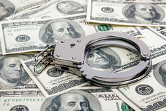 Lotto dei dollari e delle manette immagini stock libere da diritti