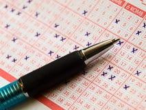 Lotto e penna Fotografie Stock Libere da Diritti
