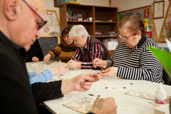 Lotto - exercises for development of attention. Day of Health in Center of social services for pensioners and disabled (Lotto - exercises for development of Royalty Free Stock Photos