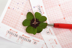 Lotto form, Four leaved clover and ballpen Royalty Free Stock Photography