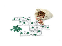 Lotto game. Wooden kegs in a sack and game cards  isolated on white background Stock Photography