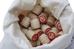 Lotto game. Wooden kegs in a sack on white Royalty Free Stock Images