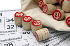Lotto game. Wooden kegs in a sack and game cards Stock Image