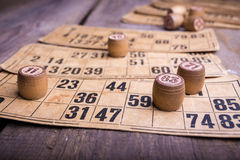 Lotto. Old wooden lotto barrels and game cards Stock Image