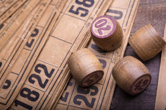 Lotto. Old wooden lotto barrels and game cards Stock Photography