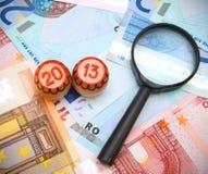 Lotto und ein Vergrößerungsglas für Euro. Lizenzfreies Stockfoto