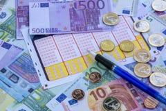 Lottsedel, pengar och penna Fotografering för Bildbyråer