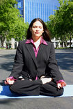 Lotus. Woman outdoors in lotus position Royalty Free Stock Image