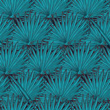 Lotus background. Floral seamless pattern with water lilies and fan palm tree leaves on deep blue background. Royalty Free Stock Images
