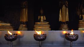 Lotus Bowl with Burning Oil Incense for Praying Buddha gods to show respect. Sacred Flame. 4k UHD stock video footage