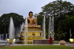 Lotus Buddha fountains with Buddhist monk Stock Image