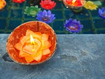 Lotus candle in a coconut shell. It is for Buddhism prays for Buddha. They are believe in Buddha. Candle light bring wishes by wat. Er royalty free stock photo