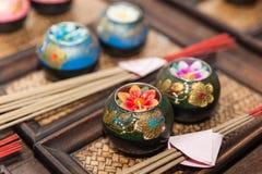 Lotus candle and joss stick for praying Stock Photos