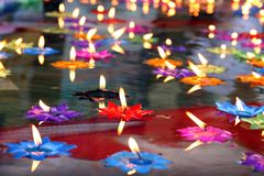 Lotus candle, lamp, lantern, light, Floating candles to be flower lotus burned on surface float on water with Buddhist beliefs. The Lotus candle, lamp, lantern stock photography