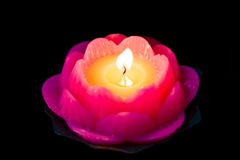 Lotus candle light illuminate a dark surrounding Royalty Free Stock Image