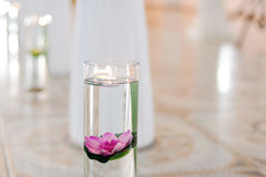 Lotus and Candle in Vase Royalty Free Stock Images